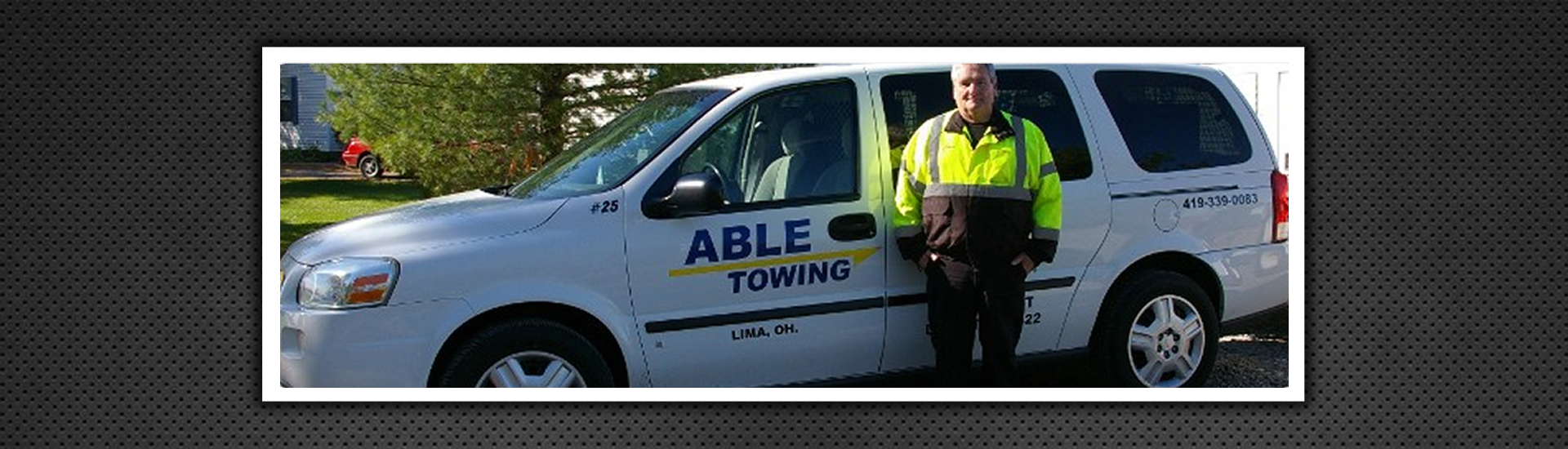 Professional Standing Infront of Able Towing Vehicle